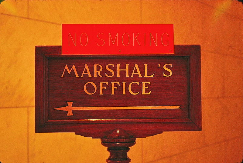 Old sign inside Capitol Building directing towards the Marshall's Office.