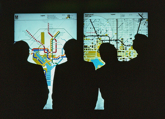 Men looking at the system map