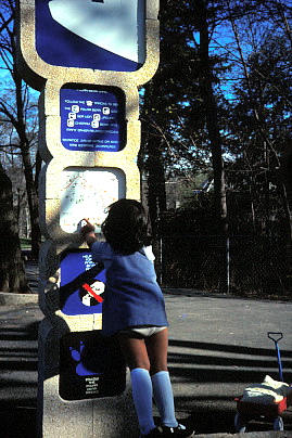 Female child looking at a totem display
