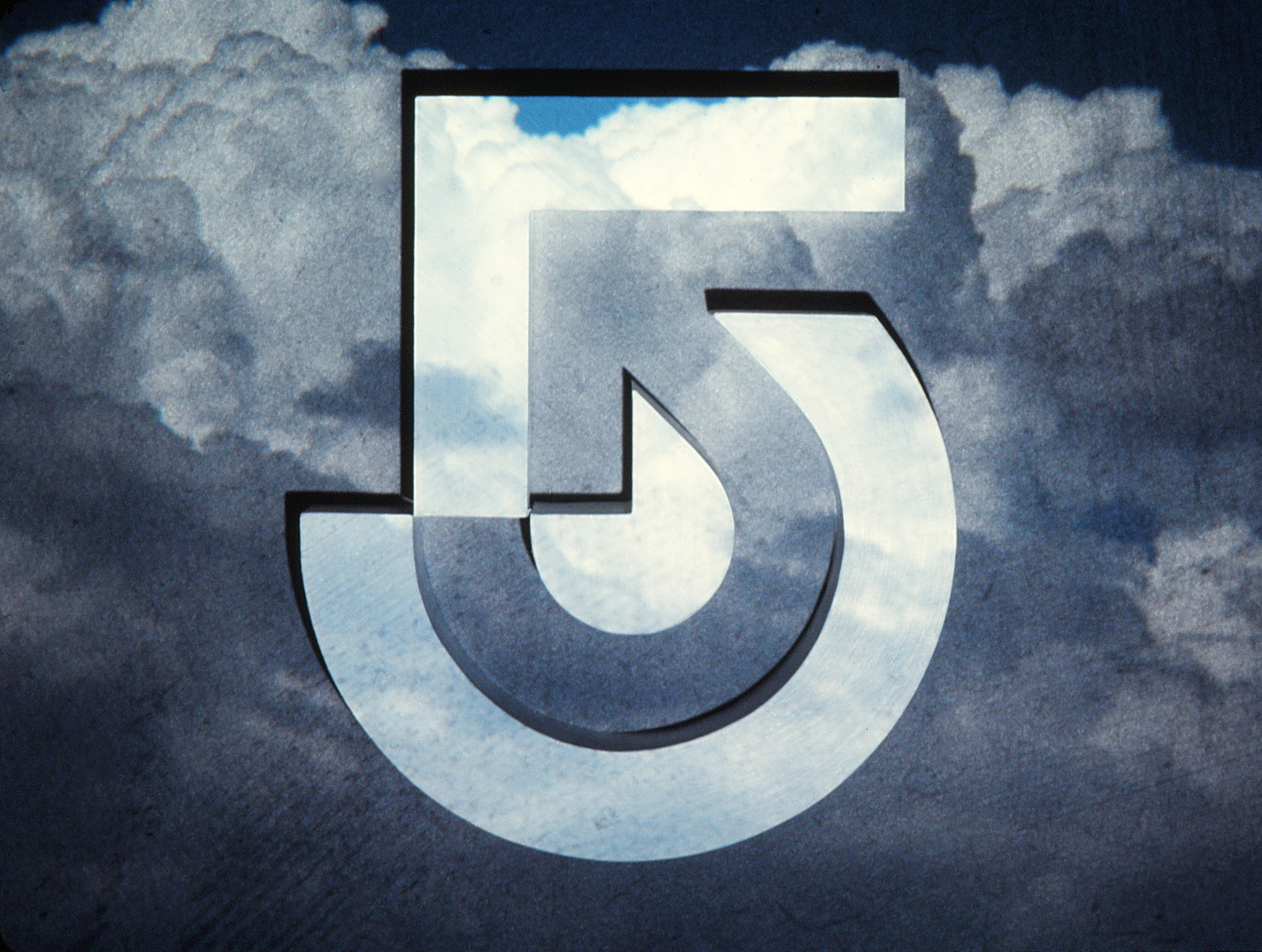 Channel 5 logo with clouds background