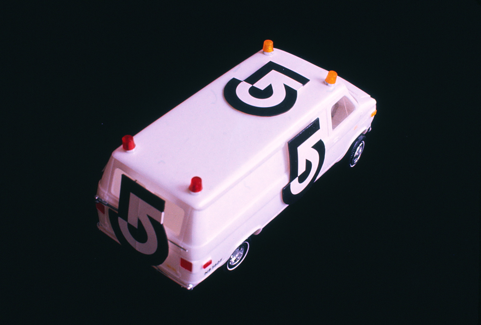 Model of van with logo on sides, back and roof